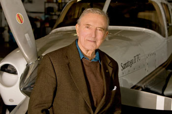 Howard Layton beside his plane